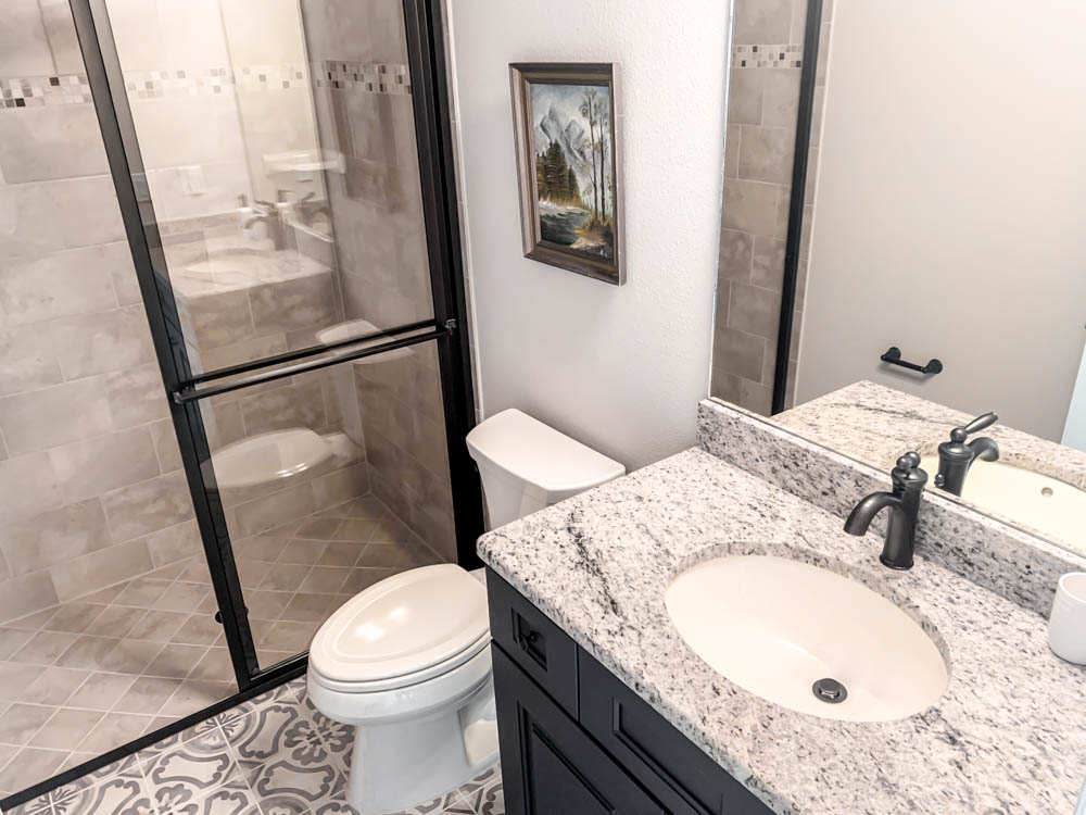 Bathroom with granite and stone